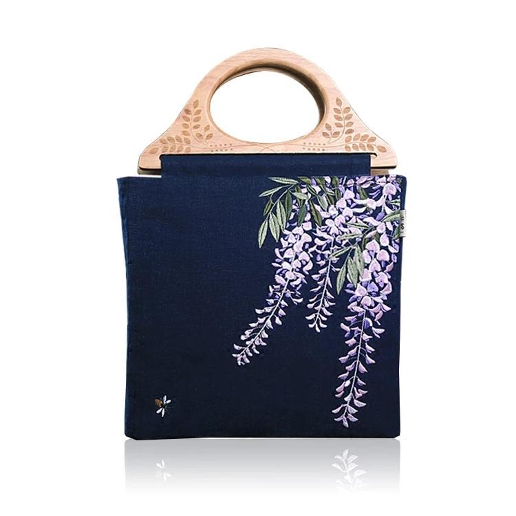 title='紫藤刺繡手提包'